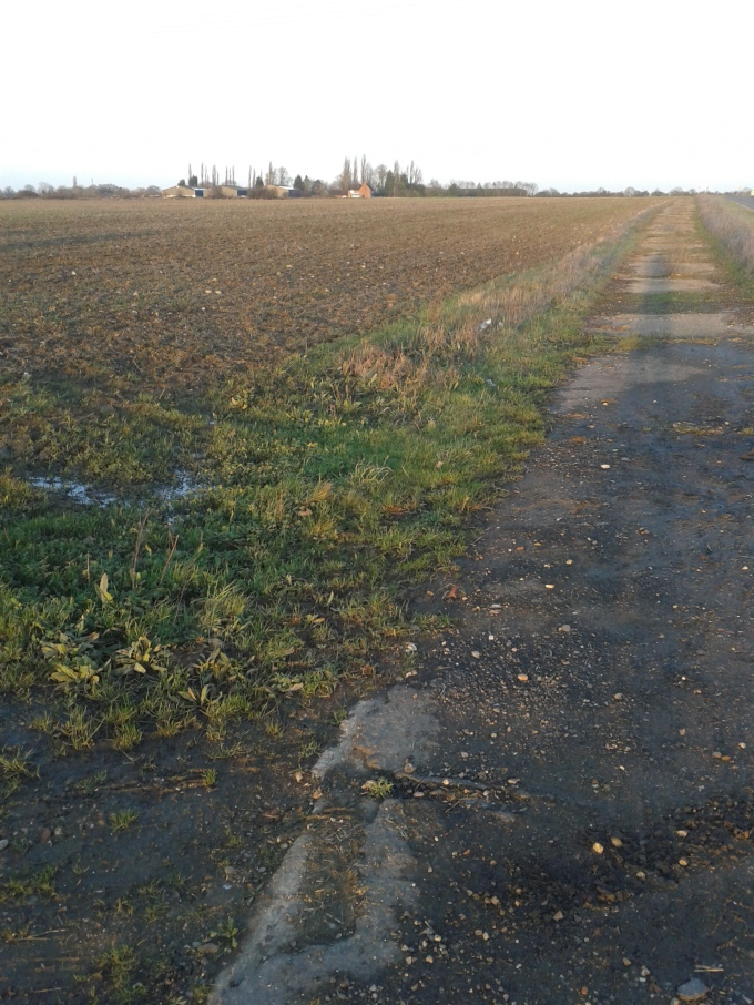 A fascinating discovery, when standing on the shoulder of the B-road which connects the villages of Stow Longa and Kimbolton, the original runway can be seen which the road was paved over in the following decades. © Brandon Wilgus, 2014.