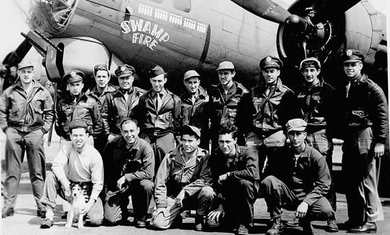 "B-17 Serial #42-32024 ""Swamp Fire"".  This is a picture of the mission crew who flew on her 25th mission on 4 May 1945 (note 24 bombs painted on her side for completed missions). Standing, left to right: TSGT Edward J. Przybyla radio operator, 2LT Harvey ""Herk"" Harris bombardier, SSGT Roy E. Avery, Jr. waist gunner, 1LT Joseph L. Korstjens pilot, SSGT Andrew Stroman, Jr. ball turret, SSGT Berj G. Bejian engineer, SSGT    John  K. Rose waist gunner, 2LT Matthew J. Scianameo navigator, SSGT Elijah W. Lewis tail gunner, 2LT Byron B. Clark copilot, Lt. Scragg swamp fire's mascot.  Kneeling left to right is the ground crew: Rube Cohn, Seymour Romoff, James Abbott, Henry Gerhart and Dominick DeSalvo"