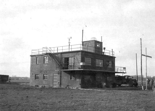 The Control Tower, now demolished, of RAF Glatton, taken on 31 March 1945. In the distance, to the left of the tower, a B-17 is visible on the taxiway. US Air Force Photograph, in the public domain.