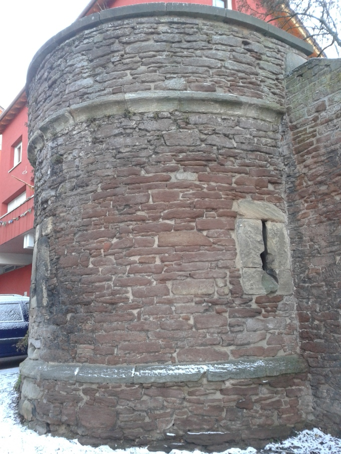 A medieval tower remained after the bombing of the castle.  It now is perched on the highstreet, between buildings from the 1950s and beyond.  A testament to the almost complete destruction of Boblingen's center. © Brandon Wilgus, 2015.