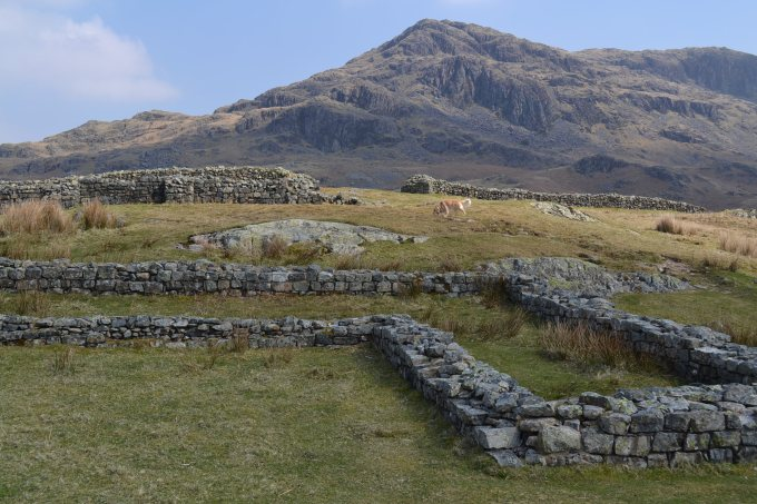 Hardknott Roman Fort, the Lake District, Cumbria. Hardknott peak is visible in the distance, and the Praetorium foundations are visible in the forground. © Brandon Wilgus, 2015.