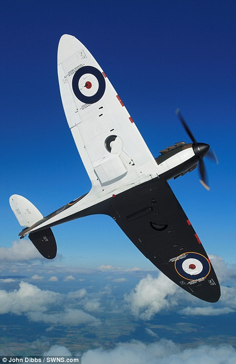 MK1 Supermarine Spitfire P9374 in flight over Cambridgeshire in 2015. © John Dibbs, SWNS.com.